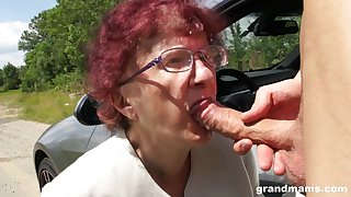 Kinky granny gives a blowjob and tugjob at hand one egregious young guy