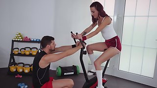 Sporty redhead likes riding the dick and making it gust