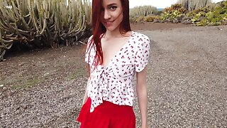 Alluring redhead with charming eyes just knows how to finger her pussy