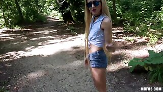 Petite stranger Empera shows ninnies in the forest and allows to penetrate pussy