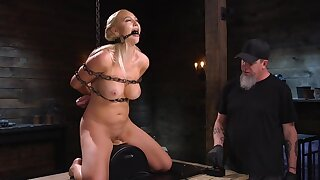 Man constraints Sybian-machine speed and girl's pleasure level