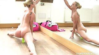 Flexible ballerina spreads her legs wide open