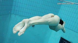 Skinny Russian teen Gazel Podvodkova loves nude swimming in a incorporate
