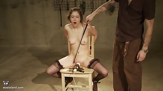 Teen pet tied up with a vibrator measure against her clit